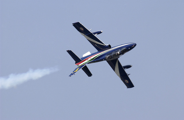 "The Italian National Aerobatics team called ""Frecce Tricolore"" performs a mini air show for the United States Air Force (USAF) personnel at Aviano Air Base, including this solo performance, prior to their scheduled performance"
