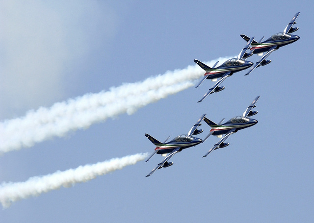 "The Italian National Aerobatics team called ""Frecce Tricolore"" performs a mini air show for the United States Air Force (USAF) personnel at Aviano Air Base prior to their scheduled performance"