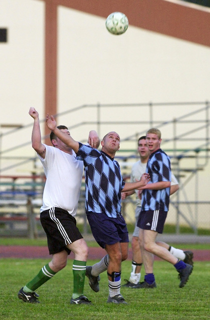 Joseph Murray playing for the Incirlik Air Base team successfully challenges John Roberts of the British Resinate North (BRN) squad for the ball while John Standley, BRN squad, during a three day soccer tournament at Incirlik Air Base in April of 2002