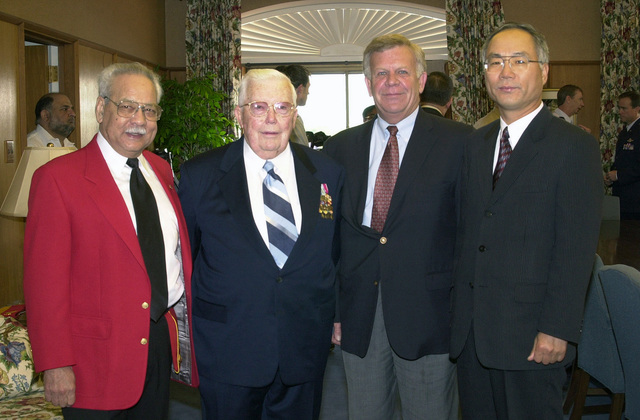 The first Commemoration of the 50th Anniversary of Korean War recognizing veterans held on Saturday, April 6, 2002 in Savannah, Georgia. Mr. George Foley (left), The States Veteran Service Officer, Captain (CAPT) James A. Naismith Jr., U.S. Navy (Ret), Mr. Frank Baker, Family Programs Coordinator at the 165th Airlift Wing (AW) and Consul Dong Yern Kim (right), Republic of Korea, pose for photo at the Savannah Electric Company before the ceremony