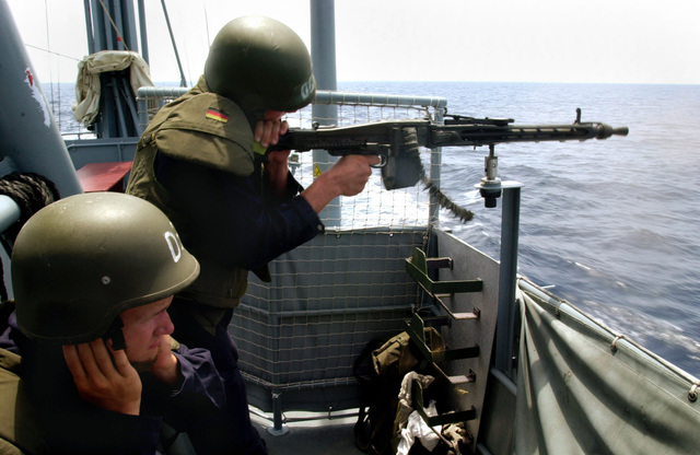In the Gulf of Aden the bullets fly as a seaman fires the 76mm L62 OTO Melara Compact gun during a gun exercise aboard the German Patrol Boat P6114 BUSSARD (Type 143 Albatross Class, S64). BUSSARD deployed to the region in support of Operation ENDURING FREEDOM, looking for smugglers and the like in the Gulf of Aden