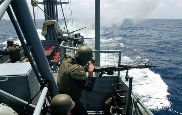 With its 76mm L62 OTO Melara Compact guns blazing, the German Patrol Boat P6114 BUSSARD (Type 143 Albatross Class, S64), commences a gunfire exercise in the Gulf of Aden. BUSSARD deployed to the region in support of Operation ENDURING FREEDOM, looking for smugglers and the like in the Gulf of Aden