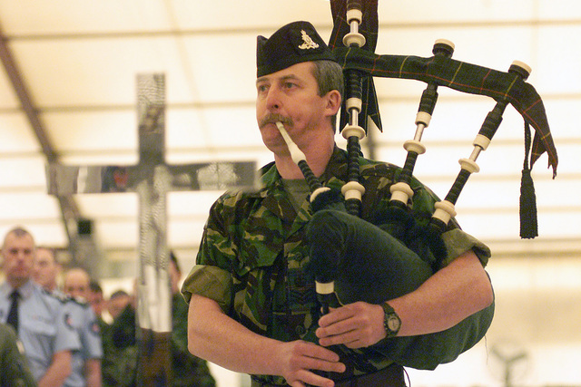 """Pipe Major, Gordon McKenzie, Royal Artillery, plays a bagpipe rendition of """"Skye Boat Song"""" for the more than 200 North Atlantic Treaty Organization (NATO) soldiers attending an Ecumenical memorial service for Her Majesty Queen Elizabeth, The Queen Mother, at Camp Butmir, in Sarajevo"""