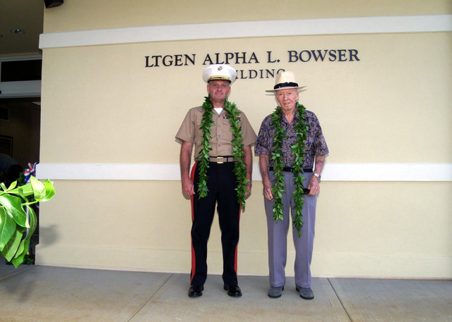 "Brigadier General (BGEN) Jerry C. McAbee, USMC, Commanding General Marine Corps Base Hawaii (MCBH) and Retired USMC Lieutenant General (L GEN) Alpha Bowser stand in front of the newly renovated LEGEN Alpha L. Bowser building at Kaneohe, Hawaii. The temporary lodging facility, known as ""The Lodge at Kaneohe"" was recently renovated and dedicated in honor of Retired LGEN Bowser"