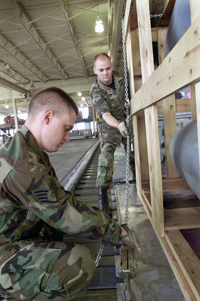 United States Air Force Usaf Staff Sergeant Ssgt Paul Ford And Ssgt David Dries Assigned To The 60th Aerial Port Squadron Aps At Travis Air Force Base Afb California Secure A Multi Pallet