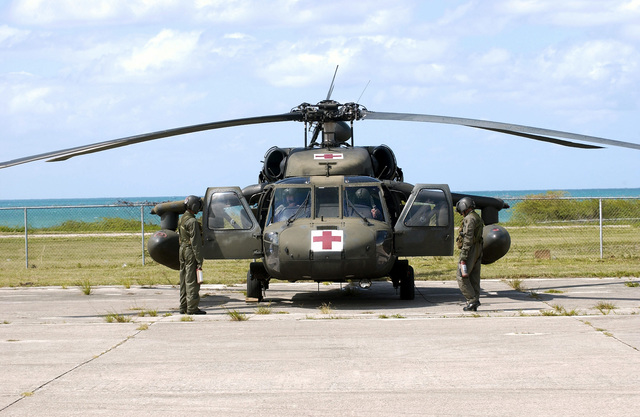 A Medical Evacuation (MEDEVAC) UH-60 Black Hawk helicopter with the 1ST Battalion, 228th Aviation Regiment (AR), from Soto Cano, Honduras, waits at the Bird International Airport, during the Tradewinds 2002 Field Training Exercise (FTX), on the island of Antigua