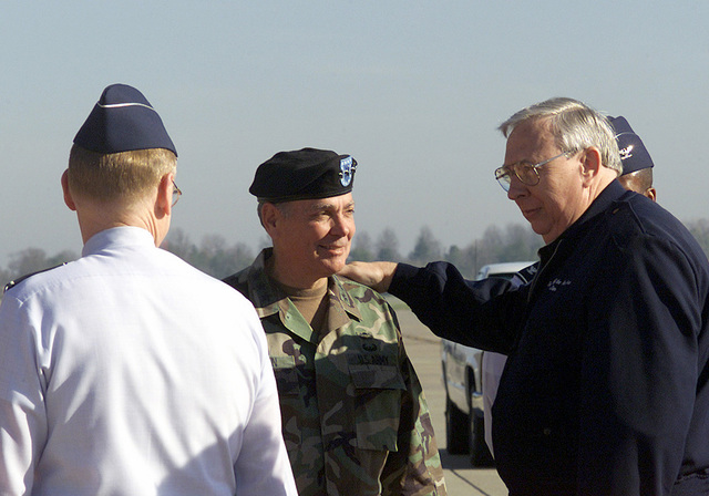Secretary of the United States Air Force (USAF), James G. Roche, arrives at Scott Air Force Base (AFB), Illinois and is greeted by Commander In Charge (CINC), General (GEN) John Handy, Lieutenant General (LGEN) Daniel G. Brown, Deputy Commander in CHIEF (DCINC), US Transportation Command, during his visit to the US Transportation Command (USTC) and Air Mobility Command (AMC) Headquarters