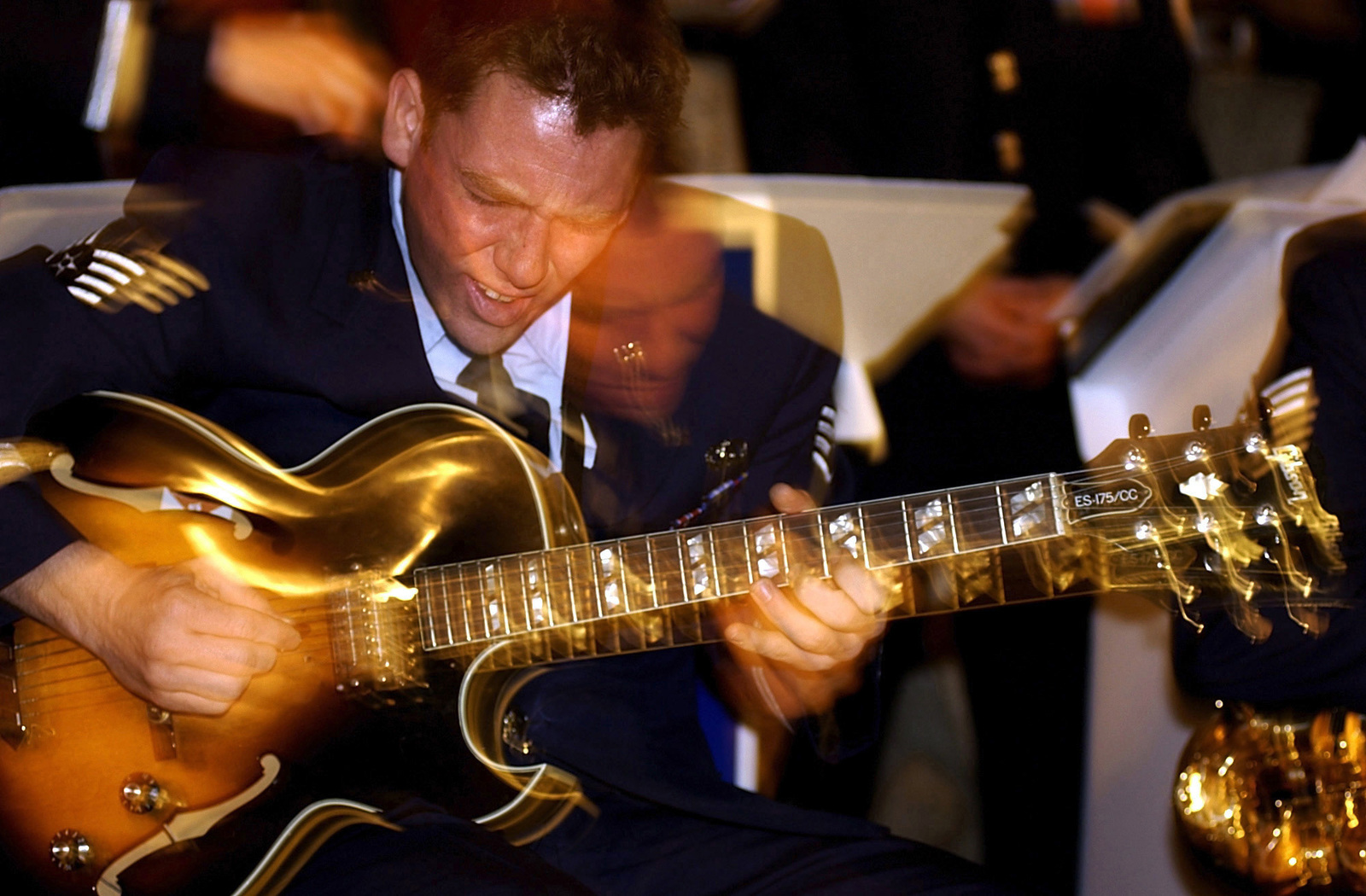 "At a festival held in Baku, Azerbaijan, STAFF Sergeant (SSGT) Gerard Birkenmeier Jr. with the United States Air Force in Europe (USAFE) Jazz Band, The Ambassadors, performs A guitar solo,""Short Story."""