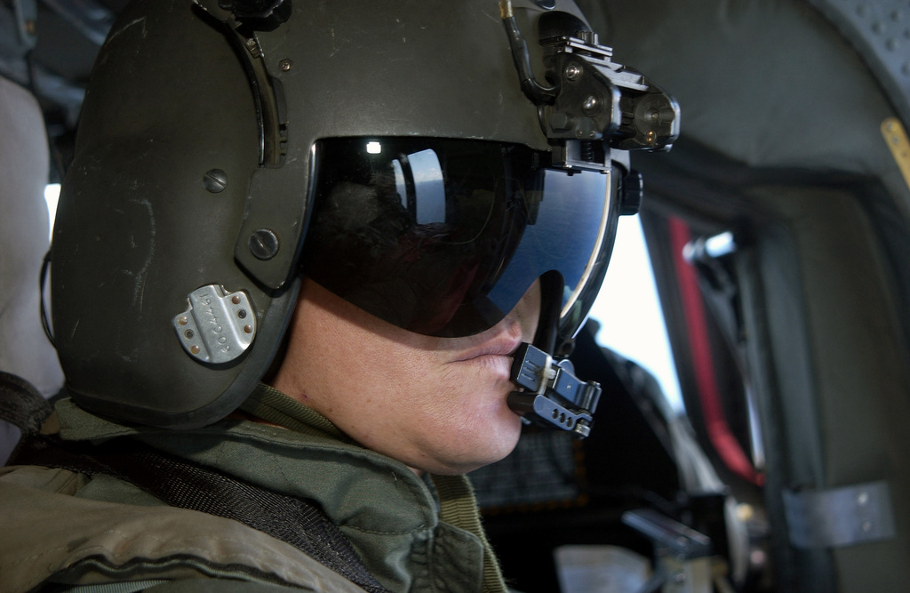 STAFF Sergeant (SSG) Rolando Correa, from Detachment, 1ST Battalion, 228th Aviation Regiment (AR), Fort Buchanan, Puerto Rico, sits in his UH-60A Black Hawk during the Tradewinds 2002 Field Training Exercise (FTX)