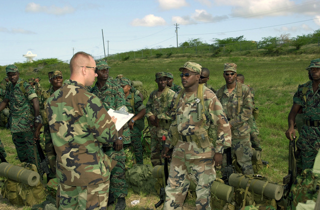 US Army (USA) Captain (CPT) John Burgeron, a USA South (USARSO) Logistician for Tradewinds 2002, calls out the names of soldiers from Foxtrot Company, 1ST Caribbean Battalion, at the V.C. Bird International Airport, during the Tradewinds 2002 Field Training Exercise (FTX), on the island of Antigua