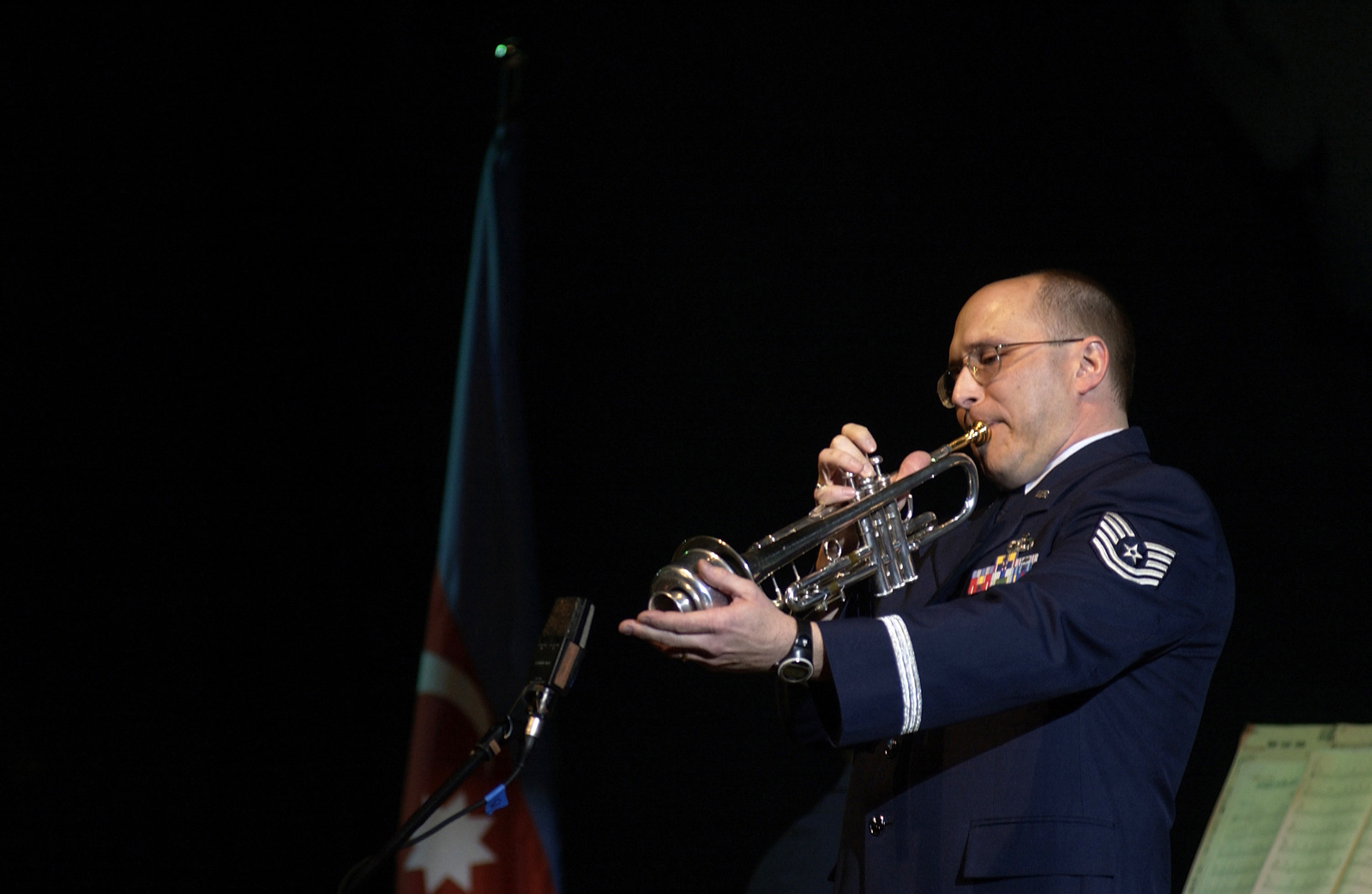 Technical Sergeant (TSGT) Scott Vignassi with the United States Air Force in Europe (USAFE) Jazz Band, The Ambassadors, performs a Trumpet mute solo during the Caspian Jazz and Blues Festival in Azerbaijan