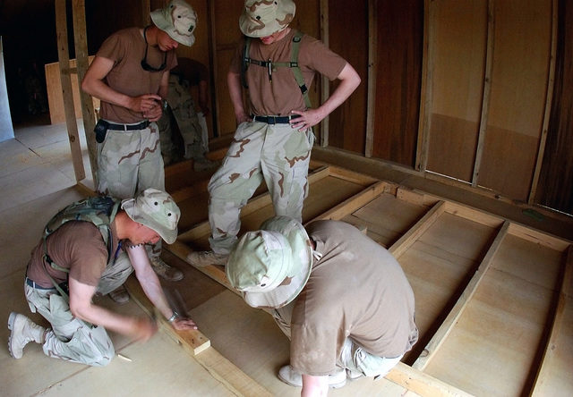 US Army (USA) soldiers, 3rd Battalion (BN), 187th Infantry (INF), start to build a storage closet for a Morale Welfare Recreation (MWR) tent at Kandahar Air Base, Afghanistan, during Operation ENDURING FREEDOM. Some 3,000 personnel on temporary duty at the base will use the tent