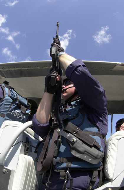 PETTY Officer Third Class (PO3) Adam Cunningham, United States Coast Guard (USCG) a gunner on board a pursuit boat, stands ready with his Colt 5.56 mm M16A2 Rifle during the Charleston Harbor's largest anti-terrorism exercise, Harbor Shield 2002, in South Carolina
