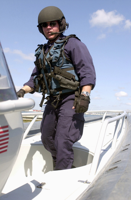 PETTY Officer Third Class (PO3) Adam Cunningham, United States Coast Guard (USCG) on board his boat during the Charleston Harbor's largest anti-terrorism exercise, Harbor Shield 2002, in South Carolina