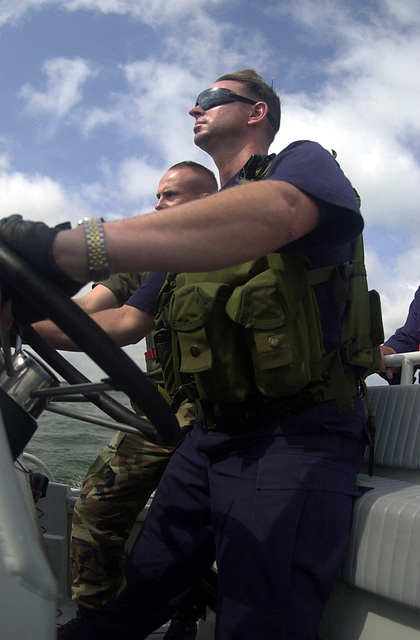 United States Coast Guard (USCG) PETTY Officer (PO) Brown, coxswain and PETTY Officer Third Class (PO3) Zimmer medical technician over see safety procedures during the Charleston Harbor's largest anti-terrorism exercise, Harbor Shield 2002, in South Carolina