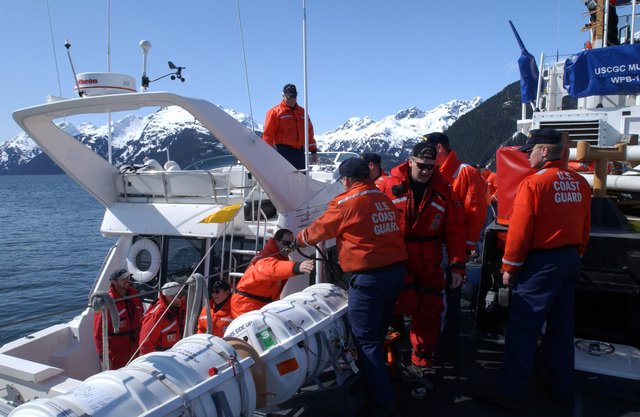 Members of a United States Coast Guard (USCG) help Special Agents with the Federal Bureau of Investigations (FBI) aboard the cutter USCG MUSTANG (WPB-310) during maritime operations in the Port of Valdez, Alaska, in support of exercise Northern Edge 2002