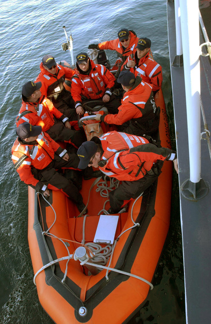 Members of a United States Coast Guard (USCG) Law Enforcement vessel boarding team and Special Agents from the Federal Bureau of Investigations (FBI) prepare to board a suspicious vessel from a Rigid Hull Inflatable (RIB) boat, during maritime operations in the Port of Valdez, Alaska, in support of exercise Northern Edge 2002