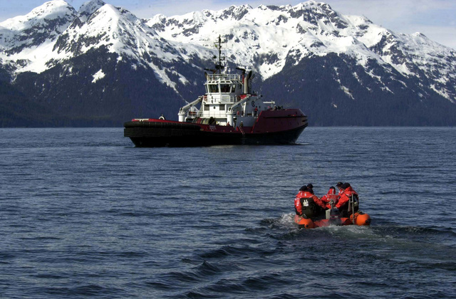 Members of a United States Coast Guard (USCG) Law Enforcement vessel boarding team and Special Agents from the Federal Bureau of Investigations (FBI) motor out to a suspicious vessel in a Rigid Hull Inflatable (RIB) boat, during maritime operations in the Port of Valdez, Alaska, in support of exercise Northern Edge 2002