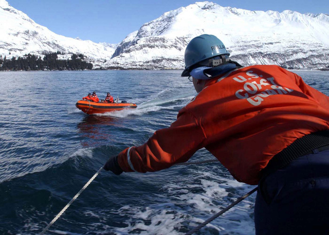 PETTY Officer Third Class (PO3) Jorge Rullan, United States Coast Guard (USCG) waits for a Rigid Hull Inflatable (RIB) boat alongside the cutter USCG MUSTANG (WPB-310) in the Port of Valdez, Alaska, in support of exercise Northern Edge 2002