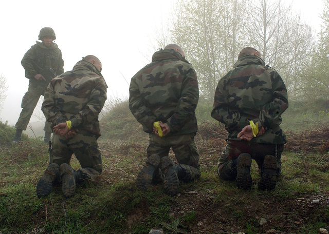 During exercise Joint Resolve 26, in Bosnia and Herzegovina (BiH), French soldiers playing the role of paramilitary extremists, are captured by the German Battle Group's 2nd Reinforced Infantry Company near a paramilitary training camp in the town of Pazaric