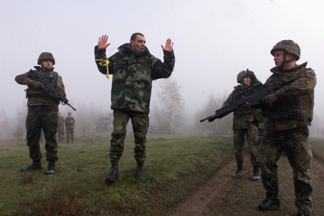 During exercise Joint Resolve 26, in Bosnia and Herzegovina (BiH), soldiers from the German Battle Group's 2nd Reinforced Infantry Company near a paramilitary training camp in the town of Pazaric, capture French soldiers who role play extremists