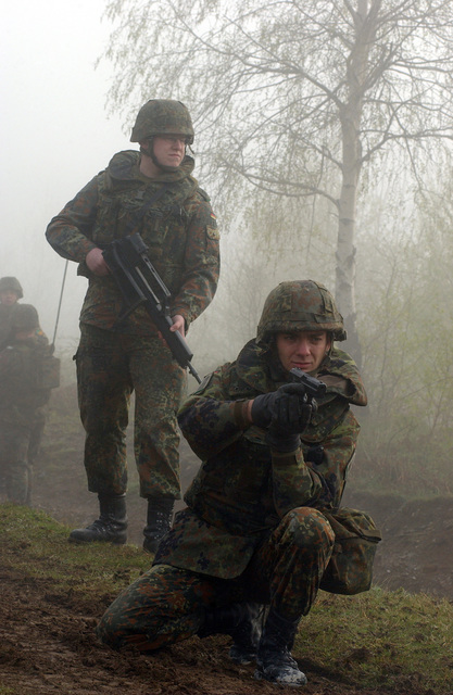 During exercise Joint Resolve 26, in Bosnia and Herzegovina (BiH), soldiers from the German Battle Group's 2nd Reinforced Infantry Company seek to capture French soldiers playing the role of paramilitary extremists, near a paramilitary training camp in the town of Pazaric