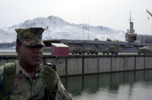 United States Marine Corps (USMC) Sergeant of the Guard (SOG), Sergeant (SGT) Emanuel Glade from Brooklyn, New York, assigned to Camp Allen, Norfolk, Virginia, is part of the Fleet Anti-Terrorism Security Team (FAST), during exercise Northern Edge 2002