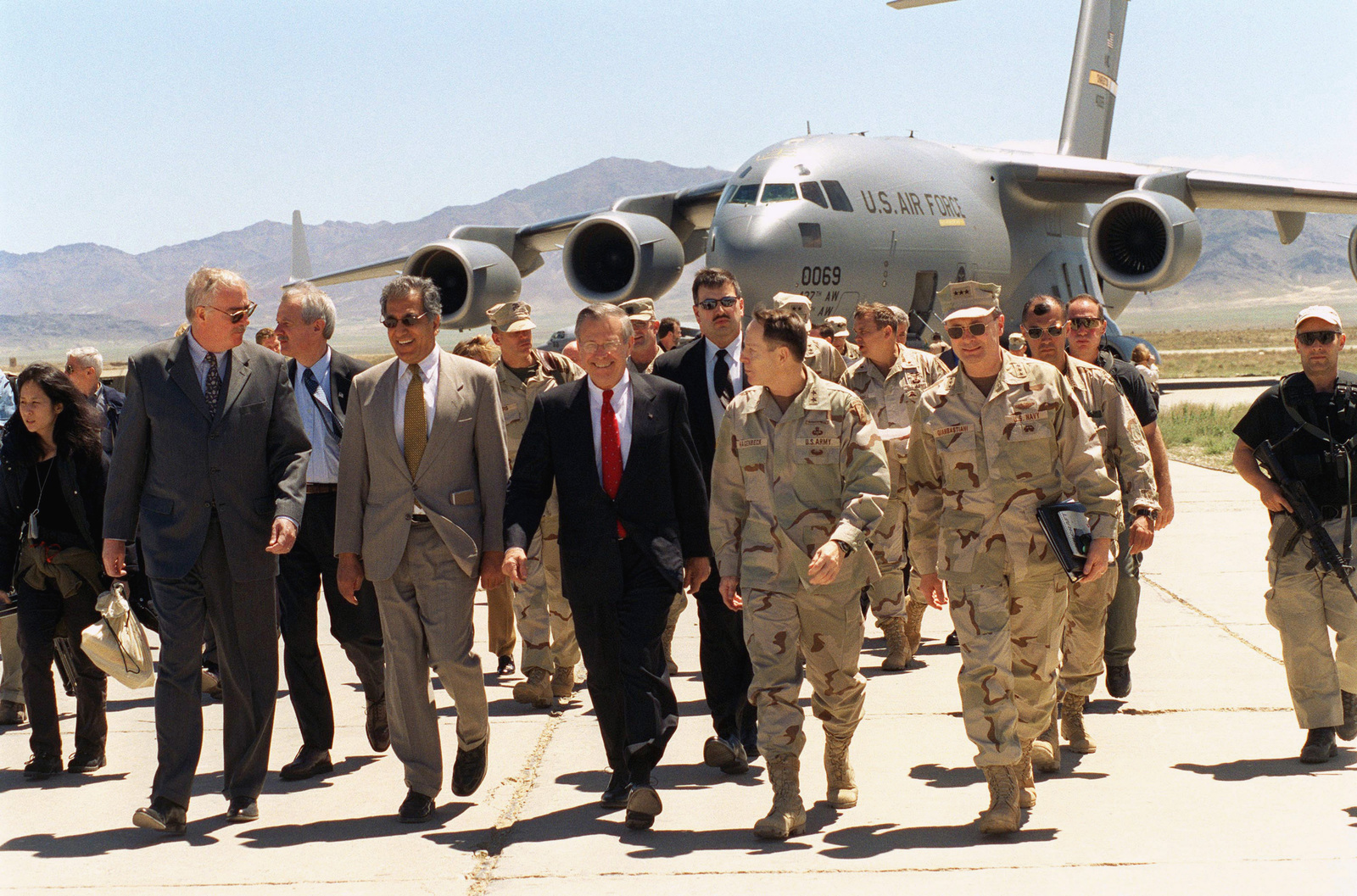 US Dignitaries offload from a US Air Force (USAF) C-17A Globemaster III aircraft after arriving at Bagram Air Base (AB), Afghanistan, to attend a briefing conducted by the Coalition Joint Task Force Commander. Pictured front row left to right, US Ambassador to Afghanistan, The Honorable Robert Finn; Presidential Special Envoy to Afghanistan, The Honorable Zalmay Khalilzad; US Secretary of Defense (SECDEF), The Honorable Donald H. Rumsfeld; US Army (USA) Major General (MGEN) Franklin L. Hagenback, Commander General Coalition Task Force; and US Navy (USN) Vice Admiral (VADM) Edmund Giambastiani, SENIOR Military Assistant to Secretary Rumsfeld