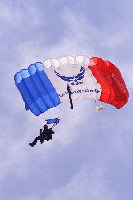 A member of the US Air Force (USAF) Stars Parachute Demonstration Team performs during the annual Open House held at Eglin Air Force Base (AFB) Florida (FL)