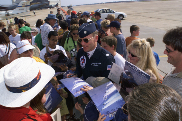 US Air Force (USAF) Lieutenant Colonel (LTC) Richard G. McSpadden (center), Commander/Leader of the USAF Thunderbirds aerial demonstration team signs autographs for spectators and fans during the annual Open House held at Eglin Air Force Base (AFB) Florida (FL)
