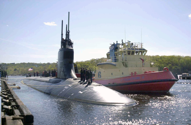 A Starboard bow view of the US Navy (USA) Seawolf Class Submarine, USS CONNECTICUT (SSN 22), showing Sailors standing on deck as the nuclear-powered attack submarine prepares to depart its homeport at Submarine Base New London, located at Groton, Connecticut (CT), for its first scheduled deployment