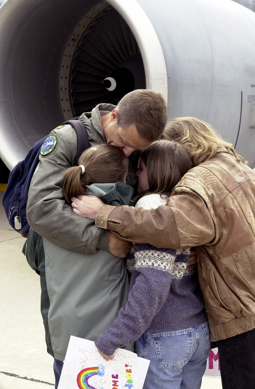A US Air Force (USAF) 128th Air Refueling Wing (ARW), Wisconsin Air National Guard (ANG) Member embraces his family after returning home at General Mitchell International Airport (IAP), Wisconsin (WI), after a deployment in support of Operation ENDURING FREEDOM