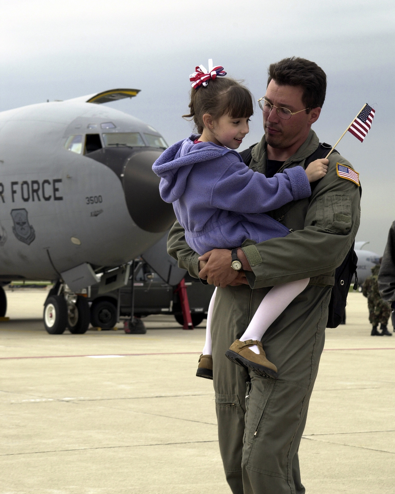 US Air Force (USAF) Technical Sergeant (TSGT) Kelly Lawrence, 128th Air Refueling Wing (ARW) Wisconsin Air National Guard (ANG) is welcomed home by his daughter on the flight line at General Mitchell International Airport (IAP), Wisconsin (WI), after a deployment in support of Operation ENDURING FREEDOM