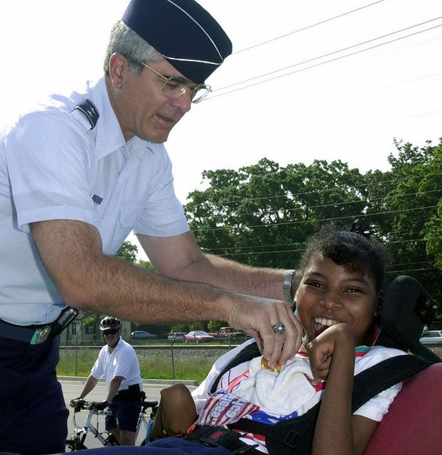US Air Force (USAF) Major General (MGEN) John F. Regni (left) Commander, 2nd Air Force, presents a medal to Veronica Nickelson, the winner of the Special Olympics, 30-meter assisted wheel chair race, during a event held at Kessler Air Force Base (AFB), Mississippi (MS)