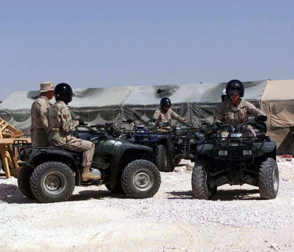US Air Force (USAF) STAFF Sergeant (SSGT) Eric Reddick (left), 379th Expeditionary Security Forces Squadron (ESFS), conducts an operational instructions class on the All Terrain Vehicles (ATV) with USAF personnel assigned to the 379th Expeditionary Communication Squadron (ECS) at Al Udeid Air Base (AB), Qatar, during Operation ENDURING FREEDOM