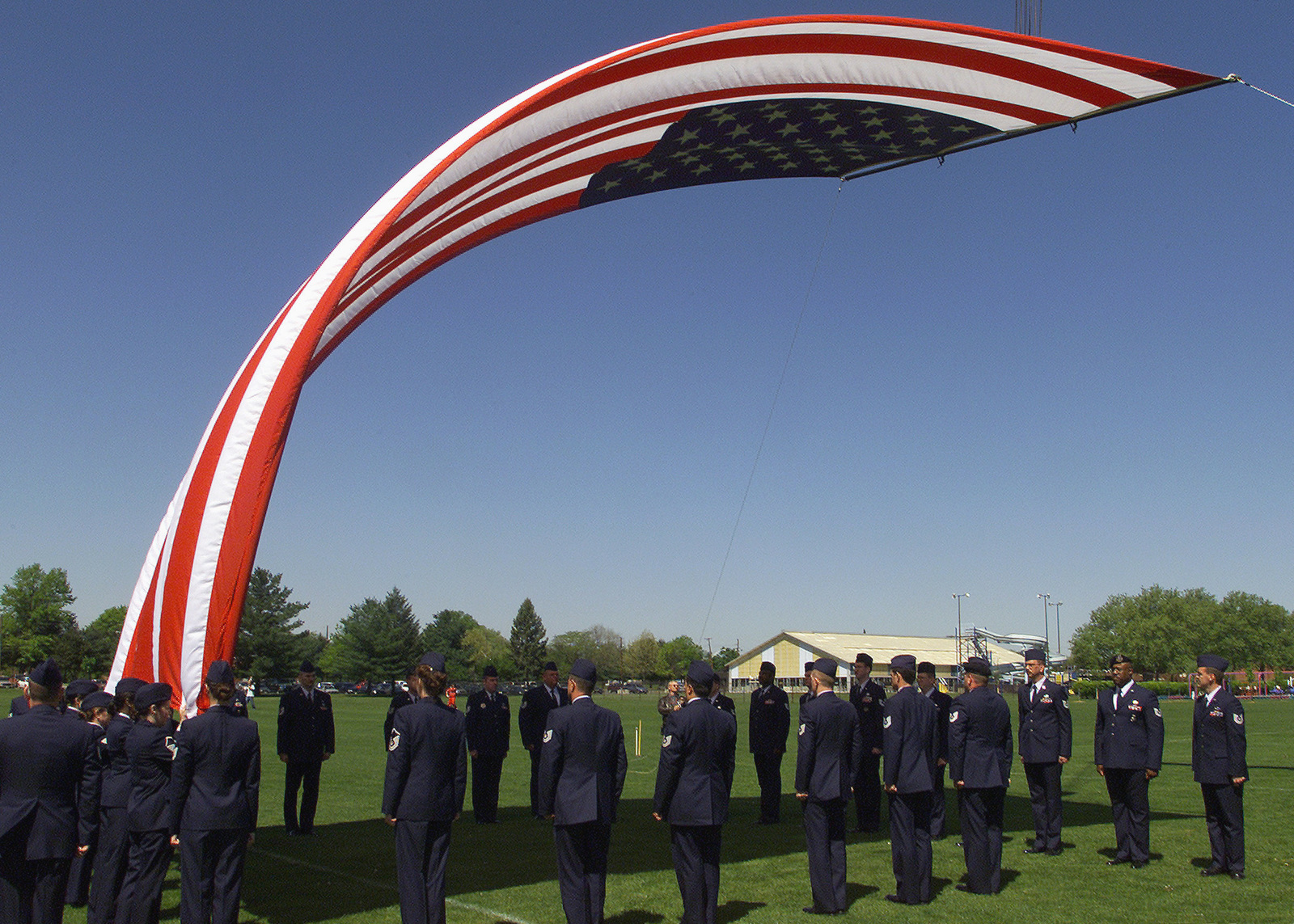 US Air Force (USAF) Non-Commissioned Officers (NCO) raise a large garrison flag during an award ceremony honoring Veterans held at Fort Dix, New Jersey (NJ)