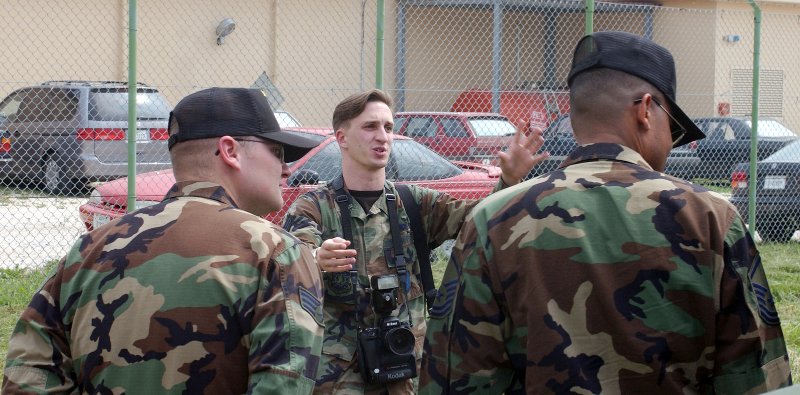 US Air Force (USAF) SENIOR AIRMAN (SRA) Edward Braly (background), a Still Photographer assigned to the 31st Communications Squadron (SC), prepares to document a photographic assignment at Aviano Air Base (AB), Italy