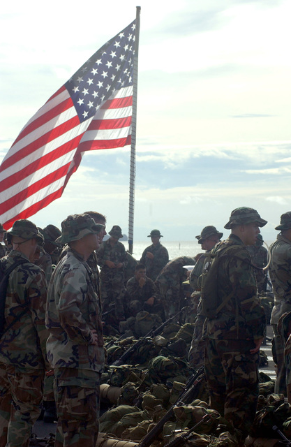 US Marine Corps (USMC) members from L Company, 3rd Battalion, 3rd Marine Regiment, 3rd Marine Division, wait with anticipation to go ashore so they can train in support of landing force Cooperation Afloat Readiness and Training (CARAT)