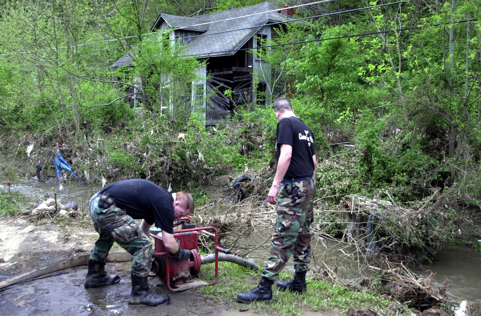 US Air Force (USAF) Firefighters from the 130th Airlift Wing (AW), West Virginia (WV), Air National Guard (ANG), pump water from the nearby creek to fill a fire truck. Firefighters from the 130th AW volunteered their services to the Coalwood, West Virginia Volunteer Fire Department after their community was ravished by flood waters