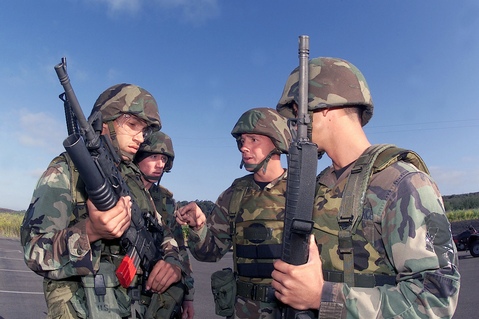 US Air Force (USAF) AIRMAN First Class (A1C) Jasen Rodriguez (left) armed with a 5.56mm M16A1 rifle with a 40mm M203 grenade launcher, listens to the instruction of his team chief, USAF First Lieutenant (1LT) Tim McCarty (center) as STAFF Sergeant (SSGT) David Ball (background), and A1C Brad Terry, look on. They are member of the 45th Space Wing (SW) Security Forces Squadron (SFS), preparing to participate the marksmanship competition at Vandenberg Air Force Base (AFB) California (CA), during Exercise GUARDIAN CHALLENGE 2002. Guardian Challenge, a four-day space and missile competition, is hosted annually at Vandenberg AFB, CA to test the wartime readiness of Air Force Space Command...