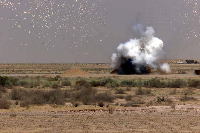 A view of an explosion detonated by US Air Force (USAF) personnel assigned to the 363rd Expeditionary Civil Engineering Squadron (ECES), Explosive Ordnance Disposal (EOD) Team, at Prince Sultan Air Base (AB), Saudi Arabia. This particular explosive has flares, which create a star effect during the day