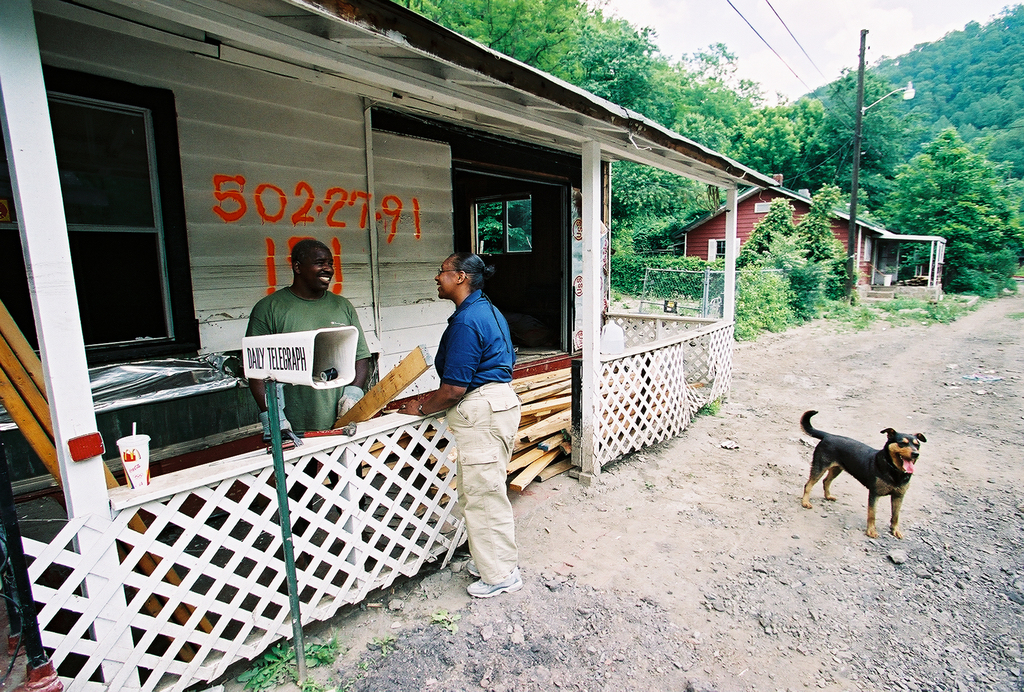 [Severe Storms, Flooding, and Landslides] Hemphill, WV, May 30, 2002 -- Charlayne Haynes of Public Affairs talks with Mike Vaughn and his dog Precious about the upcoming demolition of his home as a result of the flash flood that hit southern West Virginia on May 2, 2002.  Bob McMillan/ FEMA Photo