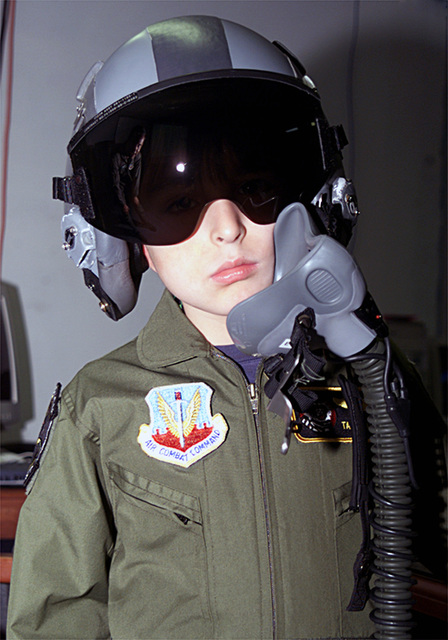 Tadd Sharp, a child selected during the Pilot For A Day Program at Ellsworth Air Force Base (AFB), South Dakota (SD), poses for a photograph while wearing fighter pilot life support gear. The Program takes terminally ill or disadvantaged children from the local community and shows them what it's like to be US Air Force (USAF) pilot for a day