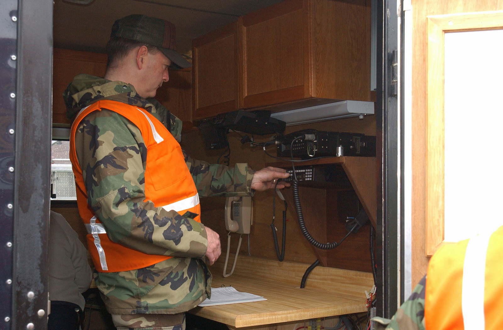 US Air Force (USAF) CHIEF MASTER Sergeant (CMSGT) Al Finkbiner, assigned to the 127th Wing, Michigan (MI) Air National Guard (ANG), adjusts the controls of the radio for the mobile command post during set up for a Military Accident Response Exercise at Selfridge, Air National Guard Base (ANGB), Michigan (MI)