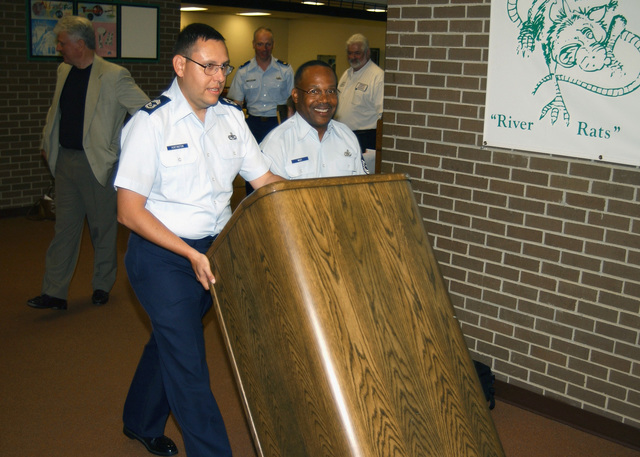 US Air Force (USAF) CHIEF MASTER Sergeant (CMSGT) Ralph Huntington (left) and USAF CMSGT Sylvester Wiley both assigned to Headquarters, Eighth Air Force, Barksdale Air Force Base, (AFB) Louisiana (LA), transport the lectern used by US President George W. Bush to address the nation from Eighth Air Force Headquarters hours after the September 11th terrorist attacks. The lectern, considered a piece of history, was inadvertently delivered to the School District in Arkansas City, Arkansas (AR), and was graciously returned to the USAF in exchange for a new one, after national media attention was drawn to the issue