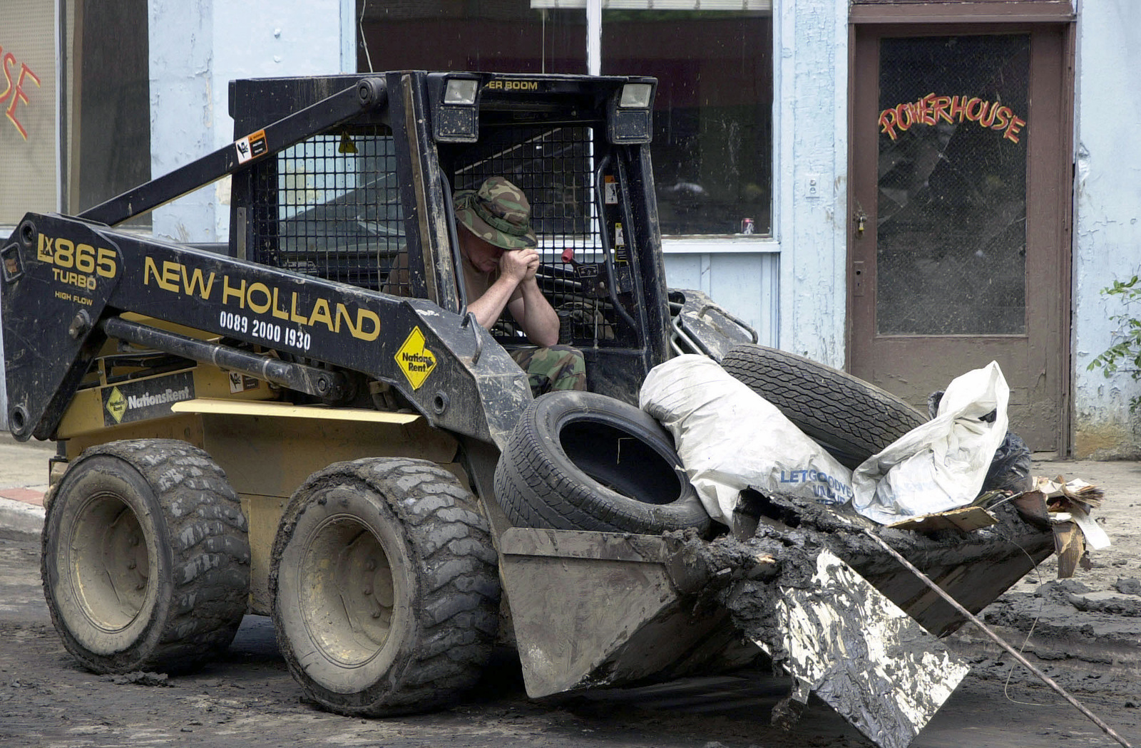 US Air Force (USAF) MASTER Sergeant (MSGT) Michael Miller, 130th Airlift Wing (AW), Civil Engineers Squadron (CES), West Virginia (WV) Air National Guard (ANG), takes a much needed break to pause and reflect on the devastation as he uses a Bobcat to help clear debris in the town of Welch, WV, following floods the devastated the City and the Southern part of the State