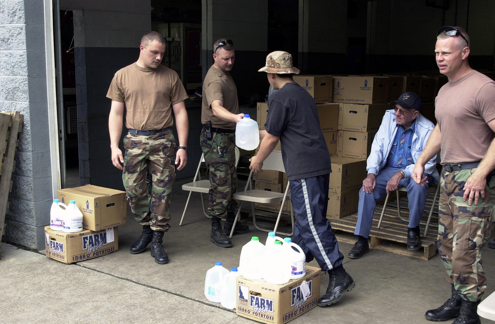 US Air Force (USAF) personnel assigned to the 130th Airlift Wing (AW), and the 167th AW, Fire Departments, West Virginia (WV) Air National Guard (ANG) distribute, water, cleaning supplies and household staples to a residents of Kimball, WV, after floods devastated the Southern part of the State