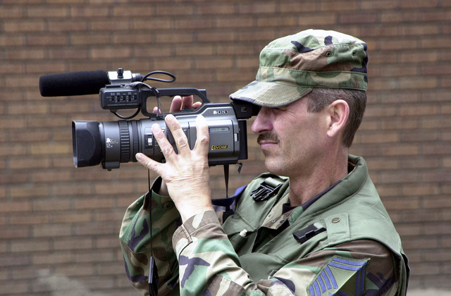 US Air Force (USAF) SENIOR MASTER Sergeant (SMSGT) Charles R. Ware, assigned to the Communications Flight, Multimedia Center, 130th Airlift Wing (AW), videotapes flood relief efforts in the southern part of West Virginia (WV), after flood waters caused millions of dollars of damage and destroyed homes and businesses