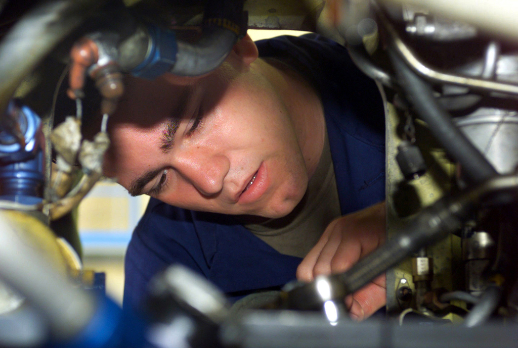 A United States Marine Corps (USMC), Corporal (CPL) Mike Martell, assigned to the Marine Medium Helicopter Squadron (HMM 263) as a mechanic, works on a hydraulic system of an AH-1W Cobra helicopter at Robins Air Force Base (AFB), in support of the Training in an Urban Environment Exercise (TRUEX) conducted in Macon, Georgia