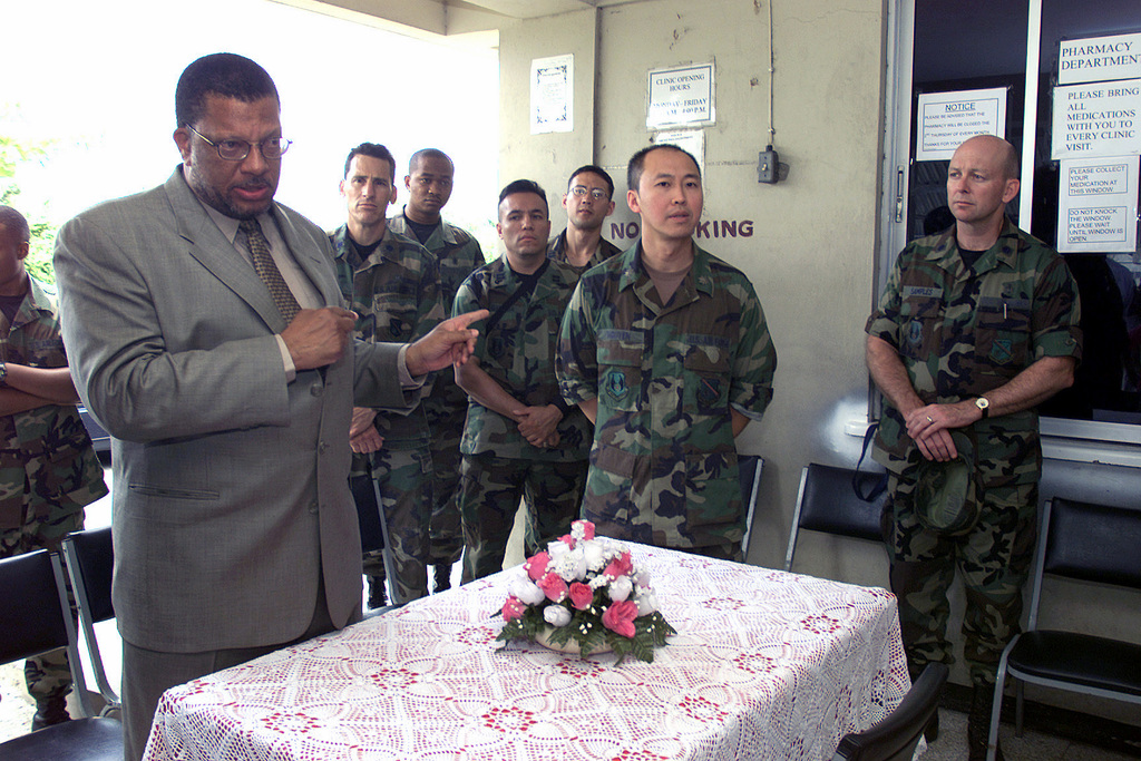 Mr. Peter Phillips (left), Jamaican Minister of National Security, introduces US Air Force (USAF) personnel from the 377th Aerospace Medicine Squadron (AMDS), who will provide medical services to the local residents at the Mayfield Park Medical Center, while deployed to Kingston, Jamaica as part of Exercise NEW HORIZONS 2002